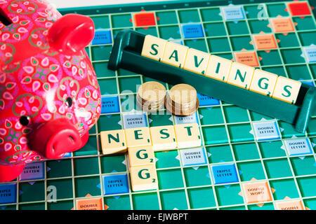 piggy bank nest egg savings money pension future save cash words using scrabble tiles to spell out, nest egg, Nest - Stock Photo