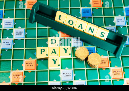 pay day loans loan money debt borrow borrowing cash debts bankrupt words using scrabble tiles to spell out - Stock Photo