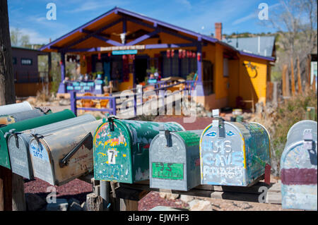 USA New Mexico NM Madrid on the Turquoise Trail mailboxes along an old coal mining town now an art community - Stock Photo