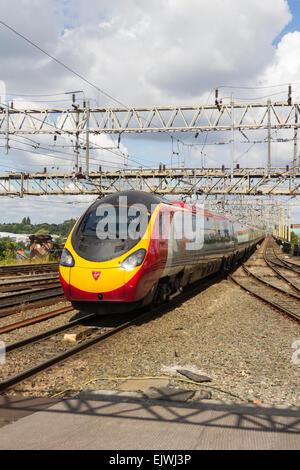Class 390 express train Virgin Pendolino 'Virgin Glory' approaching Stockport station across Stockport Viaduct. - Stock Photo