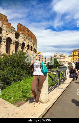ROME, ITALY - MAY 04, 2014: Girl on excursions at the Colosseum. Rome, Italy - Stock Photo