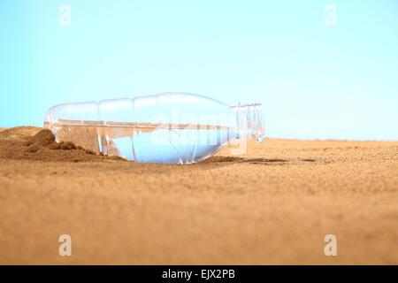 Plastic bottle on the beach - Stock Photo