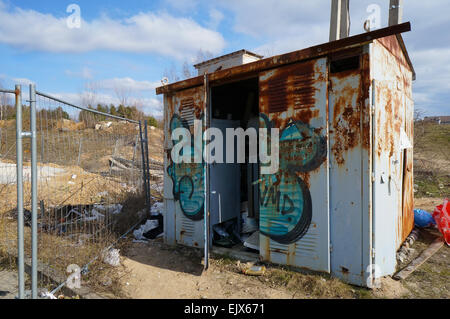 In the rusty steel  transformer box there live poor bums today.  Concept of ruin and impoverishment - Stock Photo