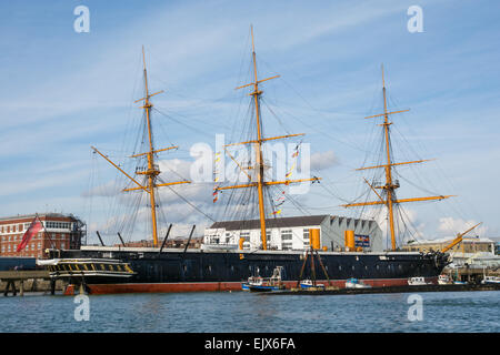 The historic Royal Navy warship HMS Warrior (1860) at her berth in Portsmouth Historic Dockyard, UK on the 5th October - Stock Photo