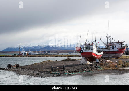 Old and new boats in Puerto Natales, Magallanes Region of Chile - Stock Photo