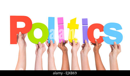 Diverse Hands Holding The Word Politics - Stock Photo