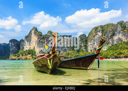 Long Tail boats at the Railay West Beach, Thailand. - Stock Photo