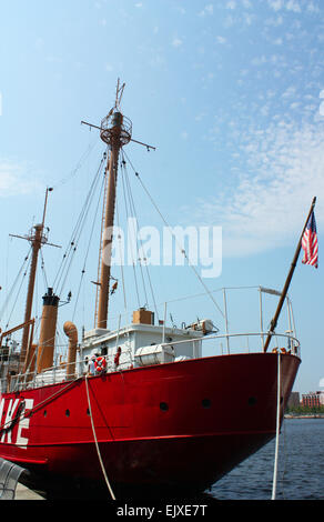 Red ship outside national aquarium in Baltimore, Maryland, USA - Stock Photo