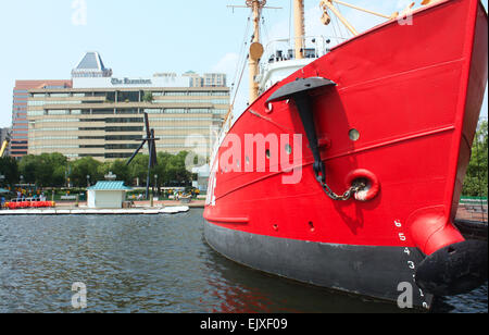 Red ship outside the national aquarium in Baltimore, Maryland, USA - Stock Photo