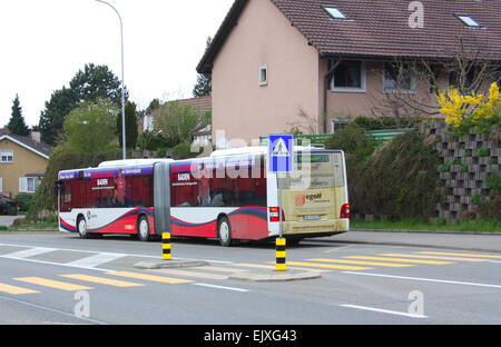 Bus on the road in Switzerland - Stock Photo