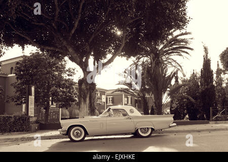 Spain, Majorca, Thunderbird vintage car in housing area - Stock Photo