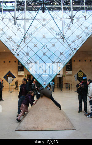 Inverted glass prims in Louvre Museum in Paris, France - Stock Photo