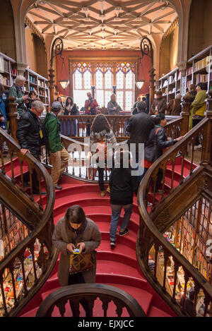 Tourists inside the lello library,Along with Bertrand in Lisbon, it is one of the oldest bookstores in Portugal. - Stock Photo