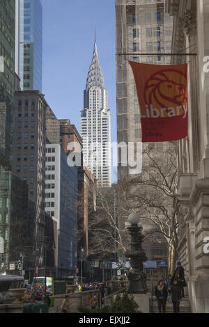 Looking east on 42nd Street from the steps of the NY Public Library with the iconic Chrysler Building looming up - Stock Photo