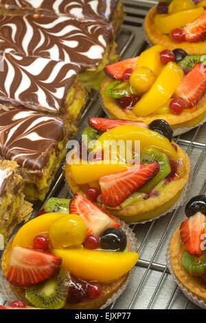 The display of pastries in a cake shop window (France). Pastry shop. Fruit tartlet. Fruits tartlets. - Stock Photo