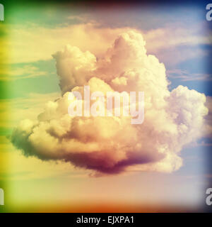 Cross processed old film style picture of a cloud. - Stock Photo