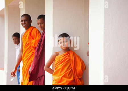 BUDDHIST MONKS STUDYING AT TEMPLE SCHOOL NEAR UNAWATUNA - Stock Photo