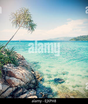 Cross processed picture of rocky shore, Koh Lipe, Thailand. - Stock Photo
