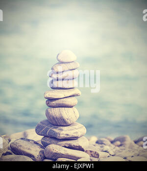 Retro filtered heap of stones, Zen spa concept background. - Stock Photo