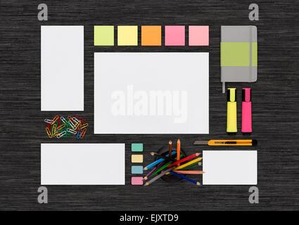 Top view of blank colorful template on black desk for corporate branding identity presentation or portfolio. Mockup - Stock Photo