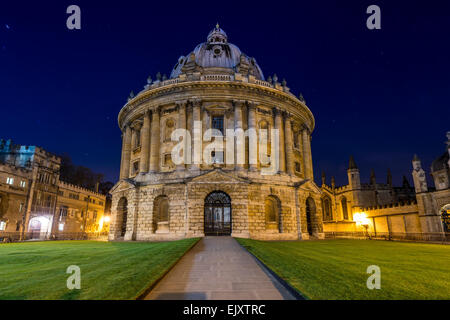 The Radcliffe Camera is a reading room of the Bodleian Library, part of Oxford University. Seen here at night. - Stock Photo