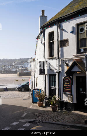 St Ives a charming historic seaside town  in Cornwall England UK The sloop Inn Pub and harbour,  which featured - Stock Photo