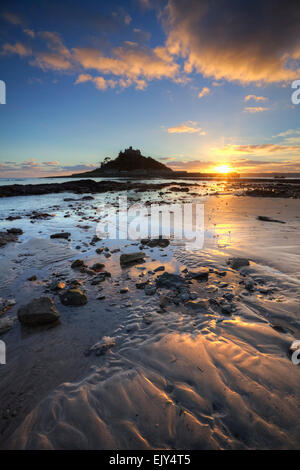 St Michael's Mount captured at sunset, from Marazion Beach. - Stock Photo