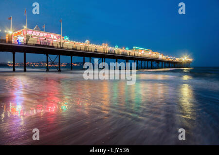 Paignton Pier in Torbay, captured during the hours of twilight. - Stock Photo