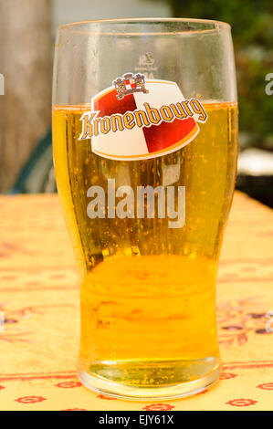 Pint glass of Kronenbourg lager - Stock Photo