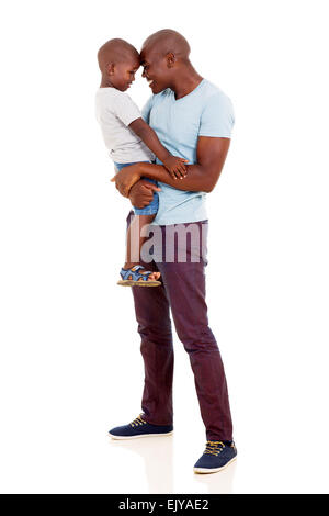 playful African man carrying his little boy on white - Stock Photo