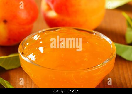 Apricot jam in glass bowl - Stock Photo