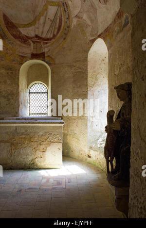 Montoire sur le Loir, Chapel of St Gilles, interior with figurine - Stock Photo