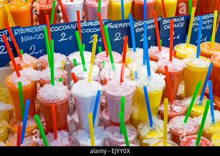 Tasty fruit juices at the Boqueria market in Barcelona - Stock Photo