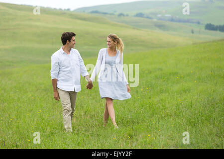 lovely couple walking on countryside - Stock Photo