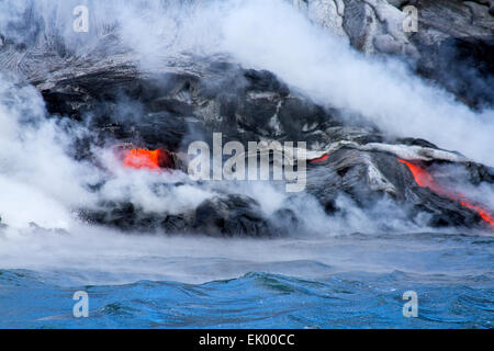 Lava from Kilauea pouring out of volcanic vent and flowing into the pacific ocean, Big Island, Hawaii, USA - Stock Photo