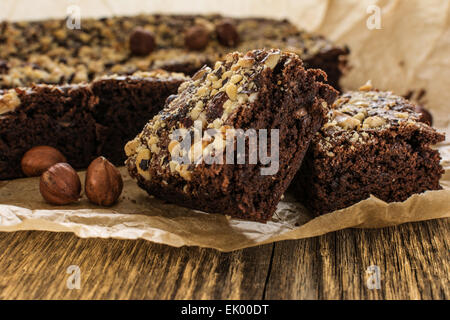 Cocoa and chocolate brownies dessert with hazelnut on wood table - Stock Photo