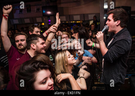Young college  students enjoying themselves at a welsh language rock music gig party dance night at Aberystwyth - Stock Photo