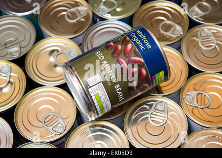 A can of red kidney beans in a drawer of canned food. - Stock Photo