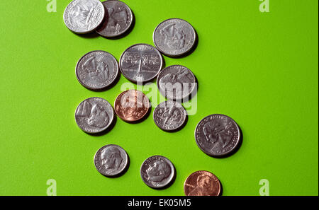 Small change, a concept. US coins on a green table. Green is the color of money. - Stock Photo