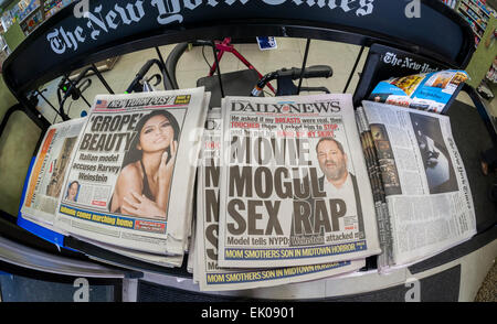 The NY Daily News is seen amidst the NY Post, the NY Times and the Wall Street Journal on a newsstand in New York - Stock Photo