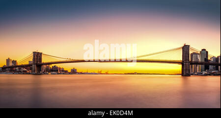 Brooklyn Bridge panorama at sunset - Stock Photo