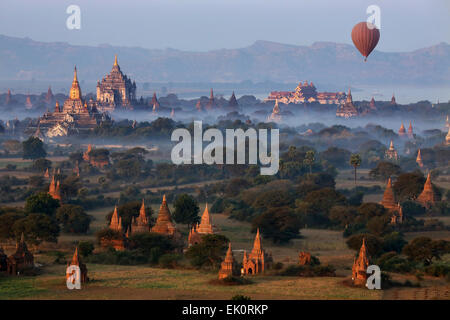 Early morning aerial view of the temples of the Archaeological Zone near the Irrawaddy River in Bagan in Myanmar - Stock Photo