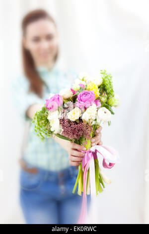 Bunch of random flowers closeup in florist's hands - Stock Photo