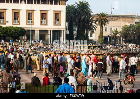 Crowd of people enjoying an afternoon in a square in Casablance, Morocco - Stock Photo