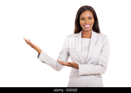 portrait of pretty African businesswoman doing welcoming gesture - Stock Photo