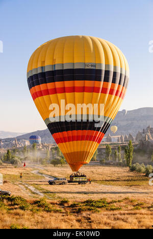 Hot air balloon landing on a trailer in Goreme, Turkey - Stock Photo