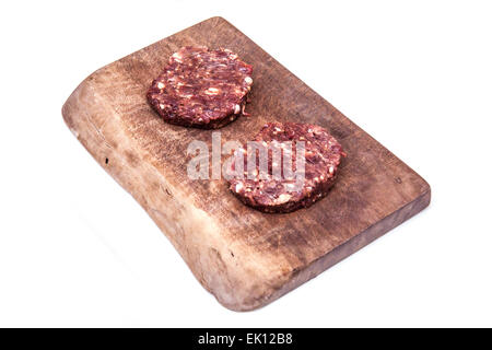 Kangaroo meat burgers uncooked isolated on a white studio background. - Stock Photo
