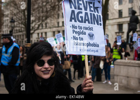 Whitehall, London, April 4th 2015. As PEGIDA UK holds a poorly attended rally on Whitehall, scores of police are - Stock Photo