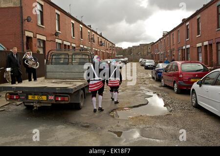 Bacup, Lancashire, England, UK, 4th April 2015. The Britannia Coco-nut Dancers dance their way through the streets - Stock Photo