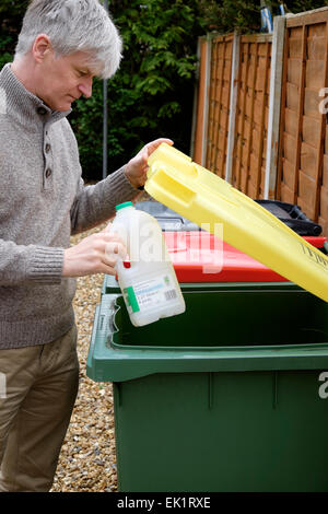 Many councils provide wheelie-bins for the recycling of household waste such as paper, plastic, tin and glass. - Stock Photo